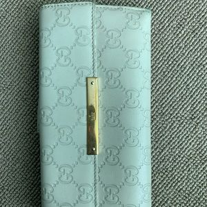 Gucci leather ivory wallet women's